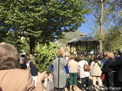 2公園でオリーブの葉を持った人たち
